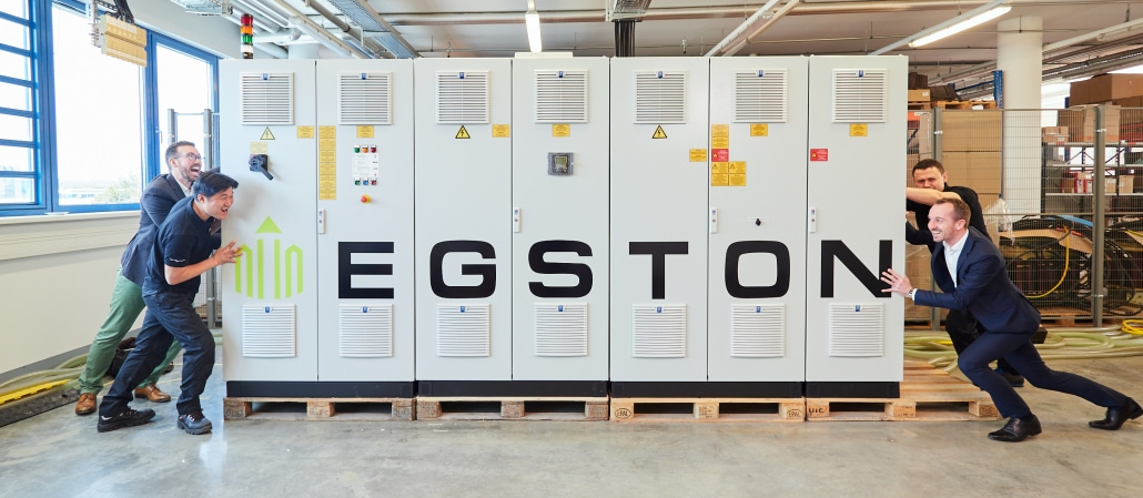 EGSTON Power Team pushing the COMPISO cabinet from both sides
